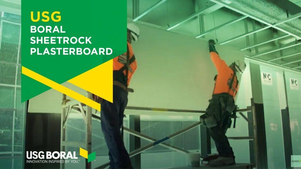 men working sheetrock board